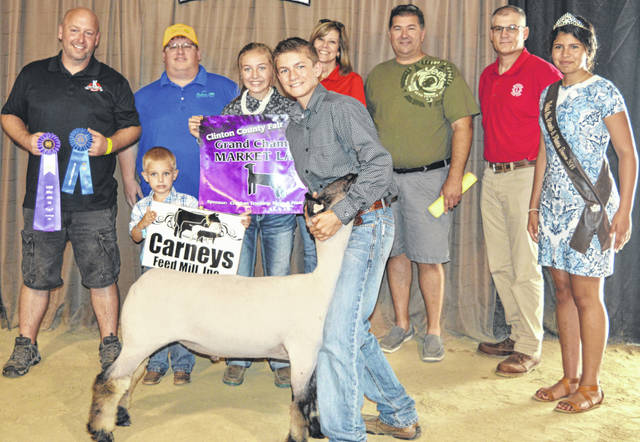 Dakota Collom's grand champion market lamb drew a $1,325 premium at the Junior Fair Market Lamb Sale on the Clinton County Fairgrounds. The buyers are ATSG (Air Transport Services Group), Accurate Soils, Achor Club Lambs Lamb Power Club, American Equipment Service, American Showa, Belles Farm Animal Veterinary Services, Bush Auto Place, Caesar Creek Animal Clinic (Dr. Matt Carey), Cherrybend Pheasant Farm / Ellis Farms, Judy Croghan, DeBold Builders, Groves Tire & Service, HuDawn Facility Solutions, JD Equipment 8 locations, LGSTX Services Inc., Lowes, Martinsville Lions Club, Janielle Runyon, Southern Hills Community Bank, Sunrise Cooperative, Wilmington Auto Center (Chrysler, Dodge, Jeep), Wilmington Lions Club, Greater Tomorrow Health, Carney's Feed Mill, and No. 1 China Buffet.