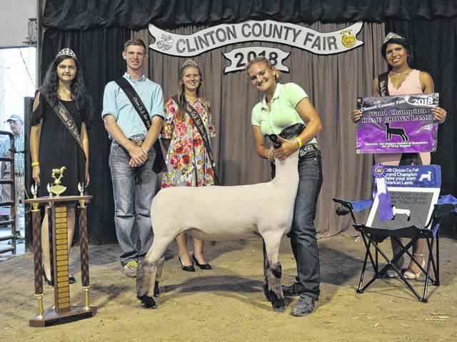 For Grand Champion Raise Your Own Market Lamb, from left are Goat Queen Jillian Richardson, Fair King Ethan Dickey-Hall, Horse Queen Kori Kile, winner Hailey Fugate, and Lamb & Fleece Queen Gracie McCarren.