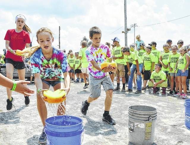 Youngsters soaked up the fun during one of the activities of the 2017 fair's annual 4-H/FFA Olympics. Members of the Adams Chiefs 4-H Club are in the background. The Adams Chiefs 4-H Club will celebrate its 75th anniversary year at a 4 to 8 p.m. reception on Monday, July 9 from 4 to 8 p.m. in the Peterson Building on the fairgrounds.