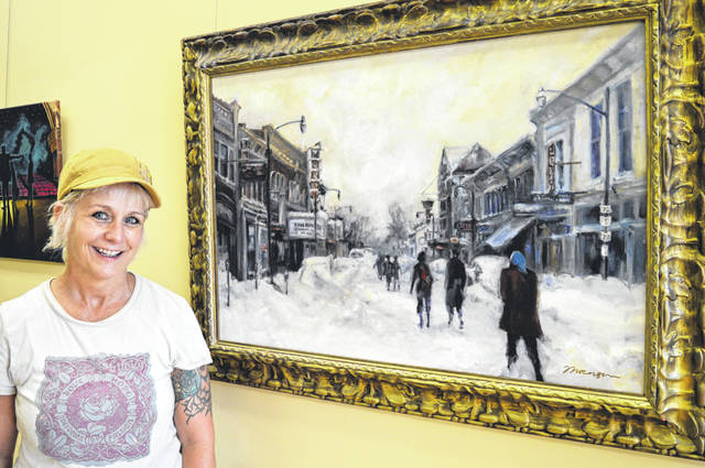 "Local artist Mary Beth Thorngren stands next to her oil painting that was based on a photograph of Main Street from the great Thanksgiving snowstorm of 1950. The artwork is her contribution to an art exhibit consisting of paintings that pay tribute to the Murphy Theatre in conjunction with the Murphy Theatre's centennial celebration. The week-long birthday party wraps up Saturday evening, July 28 with a fundraising Rock the Block concert with four different acts. Thorngren said she liked doing the painting so much she was sad when it was done. The studio also hosted an open house Friday evening, prior to the Murphy Theatre's showing of ""Lost in Yonkers"", filmed in Wilmington."