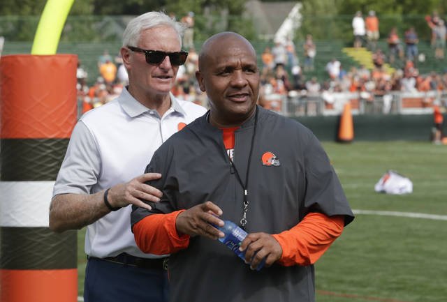Cleveland Browns owner Jimmy Haslam, left and head coach Hue Jackson watch during NFL football training camp, Monday, July 30, 2018, in Berea, Ohio. (AP Photo/Tony Dejak)