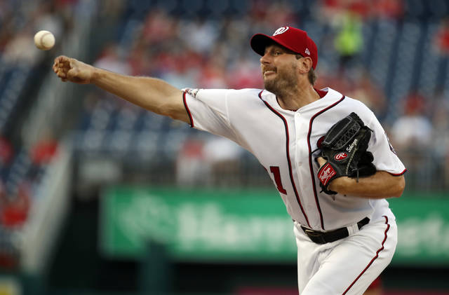 Washington Nationals starting pitcher Max Scherzer throws during the first inning of the team's baseball game against the Cincinnati Reds at Nationals Park, Thursday, Aug. 2, 2018, in Washington. (AP Photo/Alex Brandon)