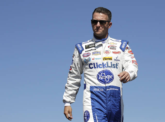 FILE - In this Sept. 24, 2017, file photo, A.J. Allmendinger is introduced prior to the NASCAR Cup Series 300 auto race at New Hampshire Motor Speedway in Loudon, N.H. Allmendinger knows his only chance to make NASCAR's playoffs is to win a race, and the road course at Watkins Glen gives him his best shot. (AP Photo/Charles Krupa, File)