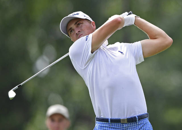 Justin Thomas watches his tee shot on the 15th hole during the second round of the Bridgestone Invitational golf tournament at Firestone Country Club, Friday, Aug. 3, 2018, in Akron, Ohio. (AP Photo/David Dermer)