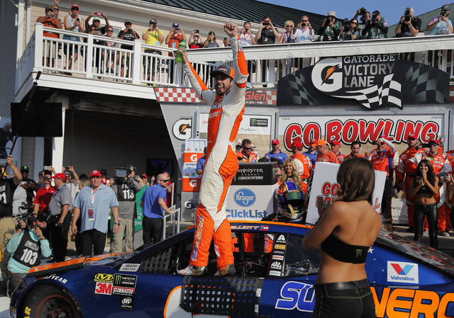 Chase Elliott, center, celebrates after winning a NASCAR Cup Series auto race, Sunday, Aug. 5, 2018, in Watkins Glen, N.Y. (AP Photo/Julie Jacobson)
