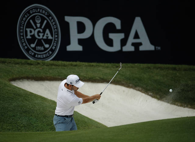 Patrick Cantlay hits onto the 6th green as he practices for the PGA Championship golf tournament Monday, Aug. 6, 2018, at Bellerive in St. Louis. (AP Photo/Charlie Riedel)