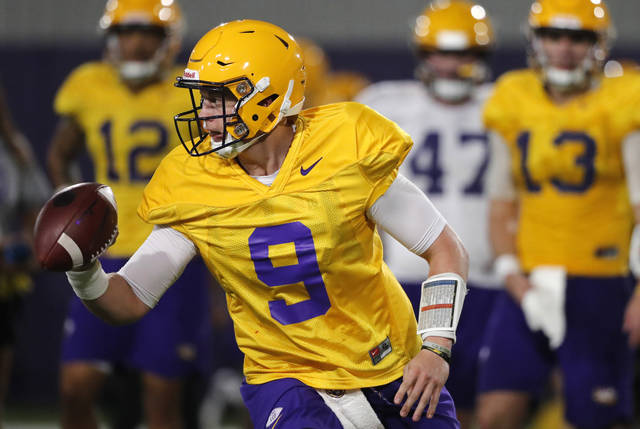 LSU quarterback Joe Burrow (9) runs through drills during their NCAA college football practice in Baton Rouge, La., Monday, Aug. 6, 2018. The former Ohio State quarterback played behind the dynamic J.T. Barrett for two seasons. Burrow will compete for a starting job with the Tigers, who are installing a spread attack under new offensive coordinator Steve Ensminger. (AP Photo/Gerald Herbert)