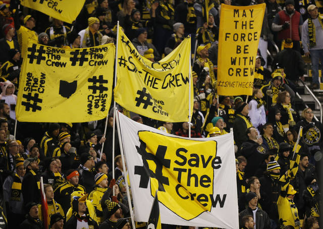 FILE - In this Oct. 31, 2017, file photo, Columbus Crew fans show their support for the team before the start of their MLS Eastern Conference semifinal soccer match against New York City FC in Columbus, Ohio. The owner of the Crew has been pushing for months to move his team to Austin. But picking up and relocating from Ohio hasn't been easy. It hasn't been a slam-dunk deal in Austin and the state of Ohio is suing to block the move. A Thursday, Aug. 9, 2018, vote on an Austin stadium plan could pave the way to Texas  (AP Photo/Jay LaPrete, File)