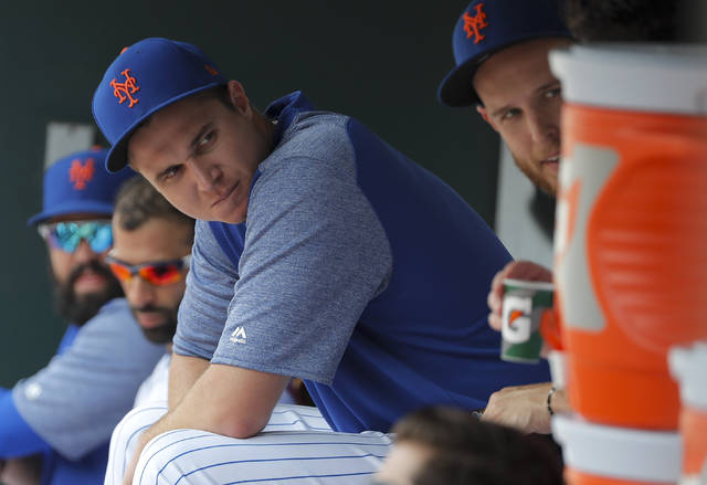 New York Mets starting pitcher Jacob deGrom (48) sits in the dugout during the eighth inning of a baseball game against the Cincinnati Reds, Wednesday, Aug. 8, 2018, in New York. deGrom struck out 10 in six innings and held the Reds scoreless in the Mets 8-0 win. (AP Photo/Julie Jacobson)