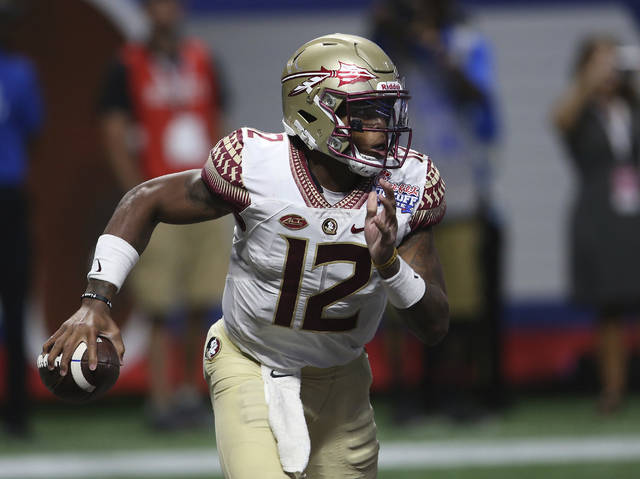 FILE - in this Sept. 2, 2017, file photo, Florida State quarterback Deondre Francois carries against Alabama during the second half of an NCAA college football game in Atlanta. Francois is happy to be playing football again and is trying to get his job back. He's back on the practice field after injuring his knee in a season-opening loss to Alabama last fall and sitting out the rest of the year. (AP Photo/John Bazemore, File)