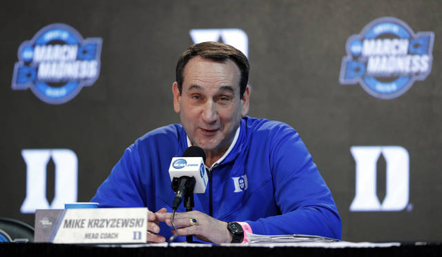 """FileThis March 22, 2018, file photo shows Duke head coach Mike Krzyzewski speaking during a news conference at the NCAA men's college basketball tournament in Omaha, Neb.  Krzyzewski doesn't believe the NCAA coordinated its reforms well enough. Speaking two days after the governing body announced numerous changes following a high-profile corruption scandal in college basketball, Krzyzewski on Friday, Aug. 10, 2018, said he approves the intent behind the changes but added that """"they don't have a plan of execution."""" Among the notable changes, the NCAA included provisions allowing agent relationships.(AP Photo/Charlie Neibergall, File)"""
