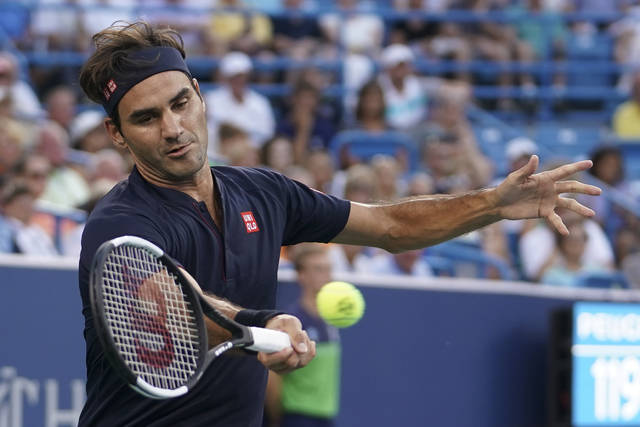 Roger Federer, of Switzerland, returns to Peter Gojowcyzk, of Germany, at the Western & Southern Open tennis tournament, Tuesday, Aug. 14, 2018, in Mason, Ohio. (AP Photo/John Minchillo)