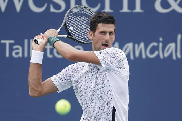 Novak Djokovic, of Serbia, returns to Adrian Mannarino, of France, in the second round at the Western & Southern Open tennis tournament, Wednesday, Aug. 15, 2018, in Mason, Ohio. (AP Photo/John Minchillo)