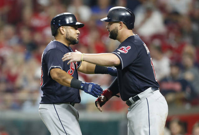 Cleveland Indians' Melky Cabrera, left, gets a hug from Yonder Alonso following Cabrera's a two-run home run off Cincinnati Reds relief pitcher Cody Reed during the sixth inning of a baseball game Wednesday, Aug. 15, 2018, in Cincinnati. (AP Photo/Gary Landers)
