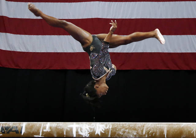 Simone Biles competes on the balance beam at the U.S. Gymnastics Championships, Friday, Aug. 17, 2018, in Boston. (AP Photo/Elise Amendola)