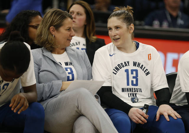 CORRECTS DATELINE TO MINNEAPOLIS INSTEAD OF ST. PAUL, MINN. - Head coach Cheryl Reeve, left, speaks with Lindsay Whalen Lindsay Whalen following her last regular season game for the Minnesota Lynx Sunday, Aug. 19, 2018, in Minneapolis. Whalen scored 10 points in the final regular-season home game of her career. The Lynx closed the WNBA basketball season with a 88-83 victory over the Washington Mystics. (Richard Tsong-Taatarii/Star Tribune via AP)