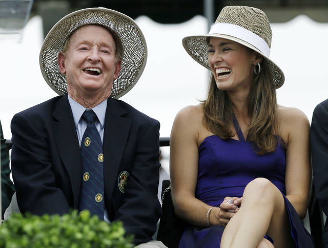 FILE - In this July 13, 2013, file photo, tennis great Martina Hingis, of Switzerland, laughs with Hall of Famer Rod Laver, of Australia, during her enshrinement into the International Tennis Hall of Fame in Newport, R.I. Hingis figures she wouldn't have needed any help from fans to earn her spot in the International Tennis Hall of Fame. Still, she likes the idea that folks around the world now will have a say in who gets elected. (AP Photo/Elise Amendola, File)