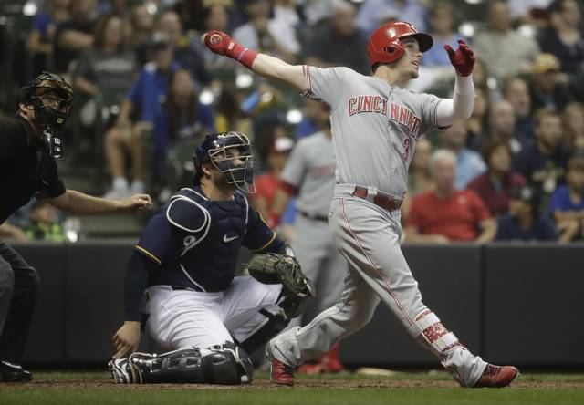 Cincinnati Reds' Scooter Gennett hits a home run during the ninth inning of a baseball game against the Milwaukee Brewers Tuesday, Aug. 21, 2018, in Milwaukee. (AP Photo/Morry Gash)