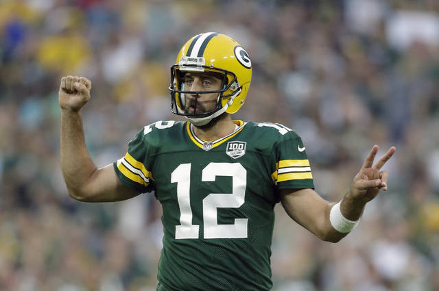 FILE - In this Aug. 16, 2018, file photo, Green Bay Packers' Aaron Rodgers gestures during the first half of a preseason NFL football game against the Pittsburgh Steelers, in Green Bay, Wis. The Packers just need to keep Rodgers upright and healthy for a full season again. A glimpse at what life is like without Rodgers showed just how precious these windows of opportunity can be with a two-time NFL MVP at quarterback.(AP Photo/Jeffrey Phelps, File)