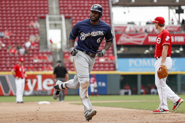 Milwaukee Brewers' Lorenzo Cain runs the bases after hitting a solo home run off Cincinnati Reds relief pitcher Austin Brice in the eleventh inning of a baseball game, Thursday, Aug. 30, 2018, in Cincinnati. (AP Photo/John Minchillo)