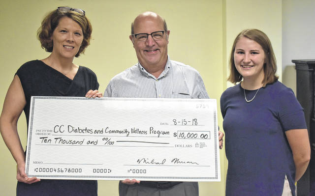 HealthFirst board member Dr. Michael Newman, middle, awards a grant check to the Clinton County Health Department's Diabetes and Wellness Coordinator Laura Knisley, right, and student intern Megan Borton, for the Clinton County Diabetes and Community Wellness Program.