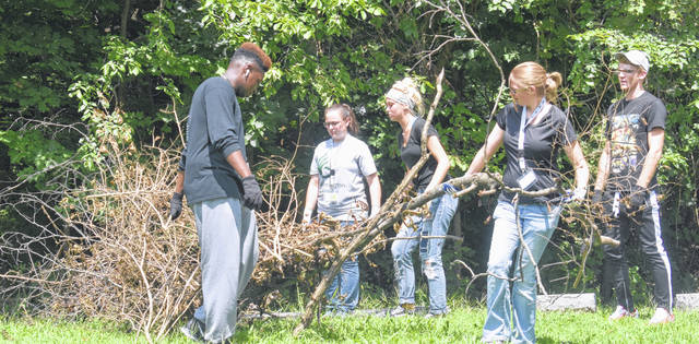 Even though classes didn't start until Monday, a group of incoming Wilmington College freshman volunteered to help clean up Sugar Grove Cemetery in Wilmington on Saturday.