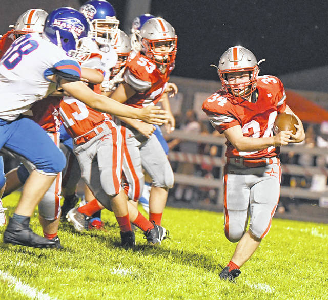 East Clinton's Brody Fisher (34) runs the ball against Clinton-Massie in the season opener for East Clinton.
