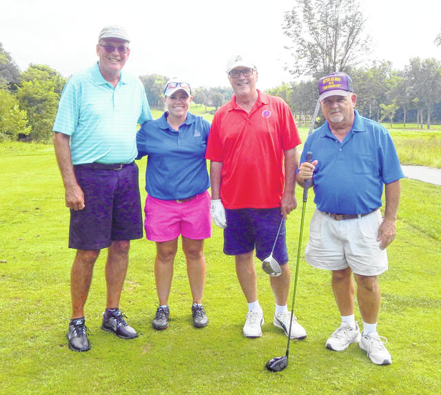 The winning team in the Habitat for Humanity golf outing Aug. 10 at the Elks 797 Golf Course, from left to right, Dennis Kruszka, Amanda Dixon, Tim Titus and Bill Kassinos.