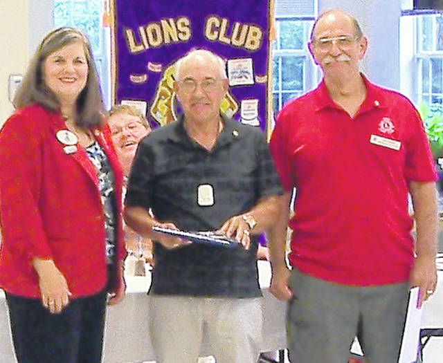 The Wilmington Lions welcomed a new member at the Monday, Aug. 20 club meeting. Visiting District Governor Lydia Houser from the Mad River Lions Club officiated at the induction ceremony of new Lion David Harp of Wilmington. The club now has 81 members. From left are Houser, (partially hidden) Lion Ryan Page, Harp, and his sponsor, Past Club President Lion John Beireis.