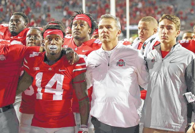 Ohio State players and head coach Urban Meyer are grim-faced following last season's loss to Oklahoma. Buckeyes have a different reason to be grim-faced nowadays in the light of allegations against Meyer.