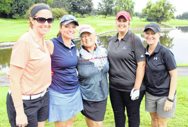 Sharon Sims is flanked by former members of her golf team, from left to right, Katie Shreck Clingner (Class of 2008), Stacey Rice Dorman ('06), Angela Santel Copsy ('07) and Amanda Wiesel ('08).