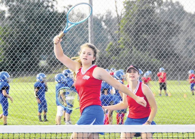 Many fall sports are underway and the News Journal takes a look at each varsity team in the four Clinton County high schools in its annual Fall Sports Preview in today's edition — which this year debuts in a magazine format. In the photo, Clinton-Massie tennis players Liza Duncan and Kari Cragwell in a match earlier this season while young football players practice in the background.