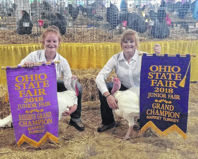 From left are Ohio State Fair reserve champion winner Jozie Jones and grand champion winner Myah Jones.