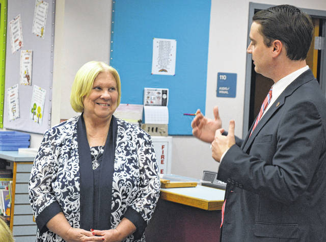 From left, East Clinton Middle School social studies teacher Nancy Reeves listens as State Board of Education member Nick Owens introduces her as the 2019 Teacher of the Year for State Board of Education District 10.