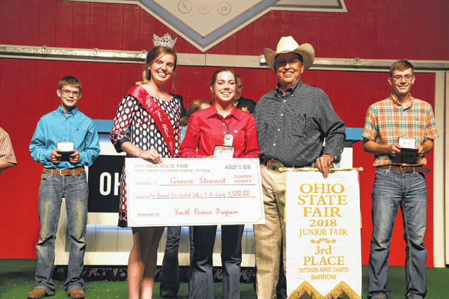 FFA member Gracee Beth Stewart of Clinton County, also a member of Blue Ribbons Kids 4-H Club, was awarded 3rd Overall Swine Outstanding Market Exhibitor at the 2018 Ohio State Fair. She also earned 14 year-old Overall Outstanding Market Exhibitor, 2nd in 14 year-old Skillathon, and 9th Overall Outstanding Breeding Gilt Exhibitor. Gracee attended the Sale of Champions at the fair to be awarded her overall check and belt buckle for her 3rd Overall Exhibitor and Overall Age Group earnings. The daughter of Billy and Jenny Stewart is a sophomore at Miami Trace High School, where she is in FFA.