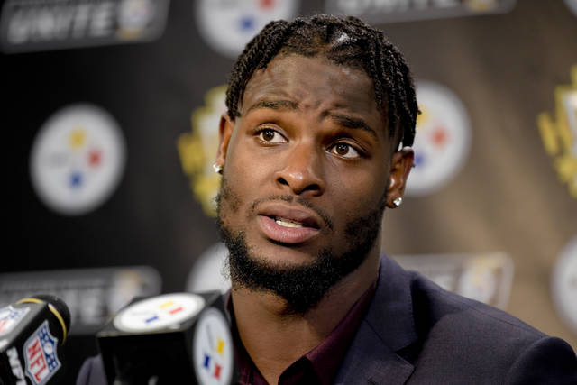 FILE - In this Oct. 22, 2017, file photo, Pittsburgh Steelers running back Le'Veon Bell (26) answers questions at a post-game meeting with reporters following a 29-14 win over the Cincinnati Bengals in an NFL football game in Pittsburgh. The Steelers are beginning preparations for their Week 1 opener against Cleveland without All-Pro running back Le'Veon Bell. Bell did not arrive at the team's facility in time for practice on Monday and has yet to sign his one-year franchise tender, leaving his status for Sunday's visit to the Browns in doubt. (AP Photo/Fred Vuich, File)