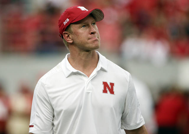 Nebraska head coach Scott Frost looks at the overcast sky before an NCAA college football game against Akron in Lincoln, Neb., Saturday, Sept. 1, 2018. (AP Photo/Nati Harnik)