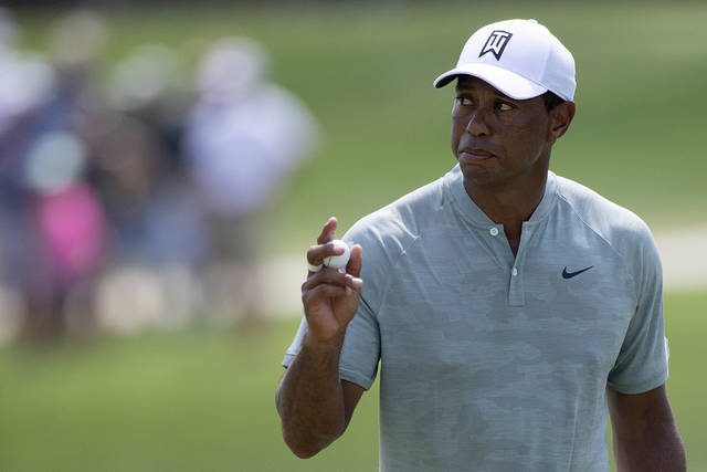 Tiger Woods of the United States reacts to his birdie on the ninth green during the first round of the BMW Championship golf tournament at Aronimink Golf Club, Thursday, Sept. 6, 2018, in Newtown Square, Pa. (Jose F. Moreno/The Philadelphia Inquirer via AP)