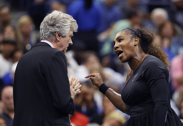 Serena Williams, right, talks with referee Brian Earley during the women's final of the U.S. Open tennis tournament against Naomi Osaka, of Japan, Saturday, Sept. 8, 2018, in New York. (AP Photo/Adam Hunger)