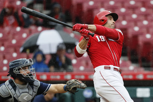 Cincinnati Reds' Joey Votto hits a grand slam off San Diego Padres relief pitcher Robbie Erlin in the second inning of a baseball game, Saturday, Sept. 8, 2018, in Cincinnati. (AP Photo/John Minchillo)