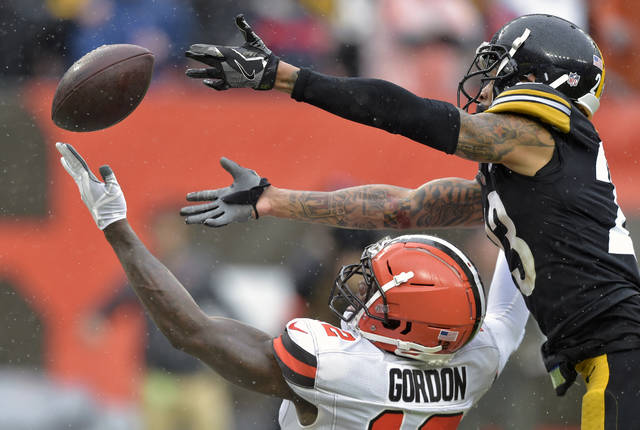 Cleveland Browns wide receiver Josh Gordon, bottom, cannot hold onto the ball under pressure from Pittsburgh Steelers defensive back Joe Haden, top, during the second half of an NFL football game, Sunday, Sept. 9, 2018, in Cleveland. (AP Photo/David Richard)