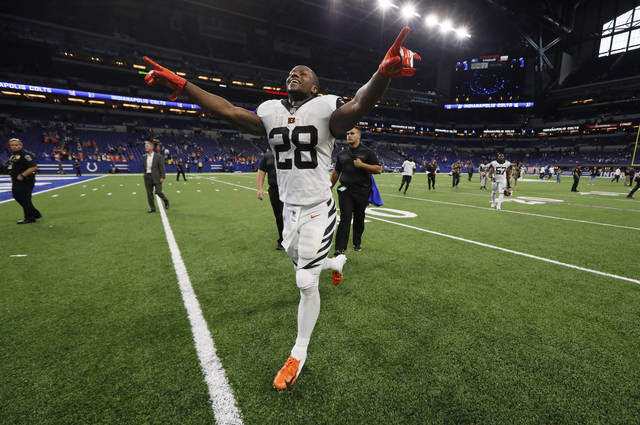 Cincinnati Bengals running back Joe Mixon (28) celebrates as he runs off the field following an NFL football game against the Indianapolis Colts in Indianapolis, Sunday, Sept. 9, 2018. (AP Photo/John Minchillo)