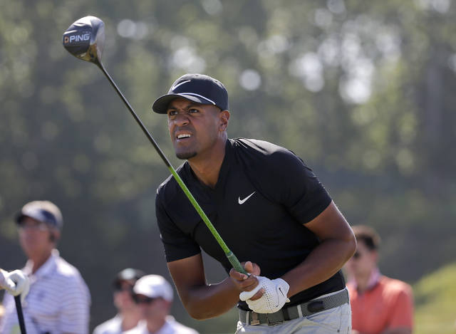 FILE - In this Sunday, June 17, 2018 file photo, Tony Finau plays his shot from the ninth tee during the final round of the U.S. Open Golf Championship in Southampton, N.Y. Tony Finau has been named to the Ryder Cup team, the final pick by U.S. captain Jim Furyk. Finau joins Bryson DeChambeau, Phil Mickelson and Tiger Woods as Furyk's four wild-card selections. Finau has 11 top-10s this season, including three in majors. (AP Photo/Seth Wenig, File)