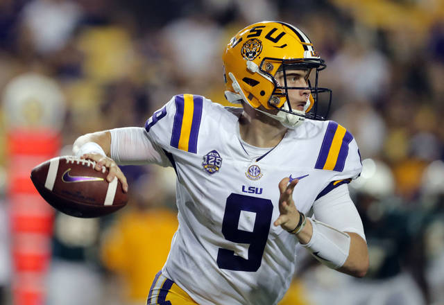 FILE - In this Sept. 8, 2018 file photo LSU quarterback Joe Burrow (9) scrambles as he looks for a receiver in the second half of an NCAA college football game against Southeastern Louisiana in Baton Rouge, La. The stage is set for another thriller for LSU at Auburn. Burrow, good but not great so far, will have to contend with a raucous crowd at Jordan-Hare Stadium and an inspired Auburn defense. (AP Photo/Gerald Herbert, file)
