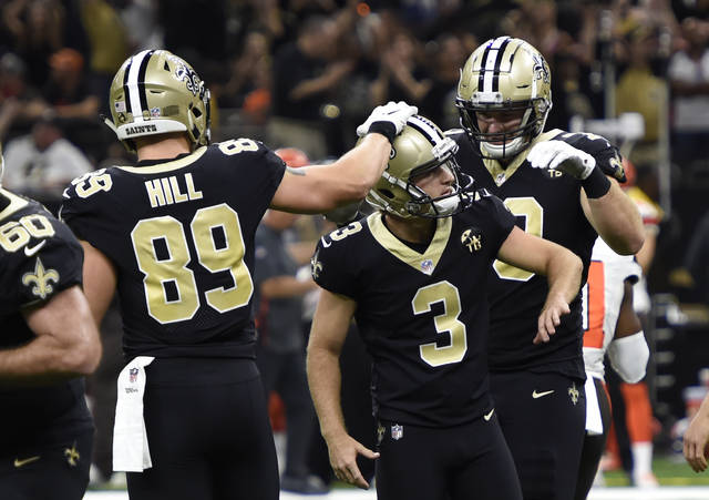 New Orleans Saints kicker Wil Lutz (3) is congratulated by tight end Josh Hill after kicking the game winning field goal during the second half of an NFL football game in New Orleans against the Cleveland Browns, Sunday, Sept. 16, 2018. The Saints won 21-18. (AP Photo/Bill Feig)