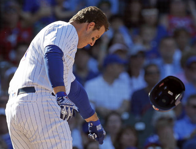Chicago Cubs' Anthony Rizzo throws his helmet after striking out against the Cincinnati Reds during the seventh inning of a baseball game Sunday, Sept. 16, 2018, in Chicago. (AP Photo/Jim Young)