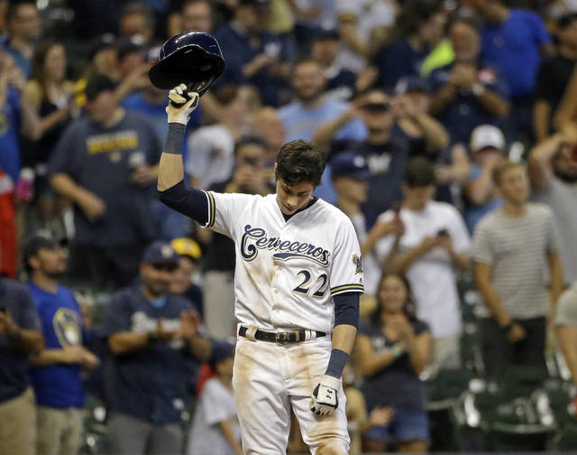 Milwaukee Brewers' Christian Yelich reacts after receiving a standing ovation from the crowd after hitting a triple to complete the cycle during the sixth inning of a baseball game against the Cincinnati Reds, Monday, Sept. 17, 2018, in Milwaukee. (AP Photo/Aaron Gash)