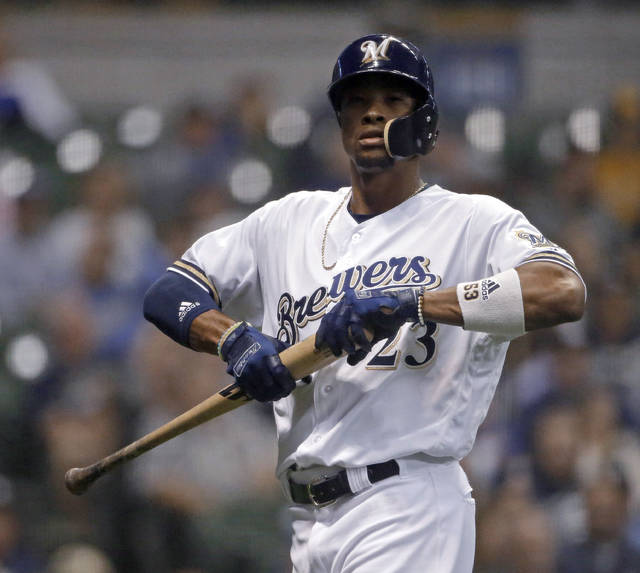 Milwaukee Brewers' Keon Broxton walks back to the dugout after striking out during the sixth inning against the Cincinnati Reds in a baseball game Tuesday, Sept. 18, 2018, in Milwaukee. (AP Photo/Aaron Gash)