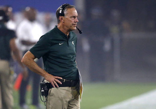 FILE - In this Saturday, Sept. 8, 2018, file photo, Michigan State head coach Mark Dantonio watches his team during the first half of an NCAA college football game against Arizona State in Tempe, Ariz. Traditional Big Ten powers Wisconsin, Michigan and Michigan State have lost out-of-conference games. Slow starts, however, doesn't mean the conference is out of the national title hunt. (AP Photo/Ross D. Franklin, File)