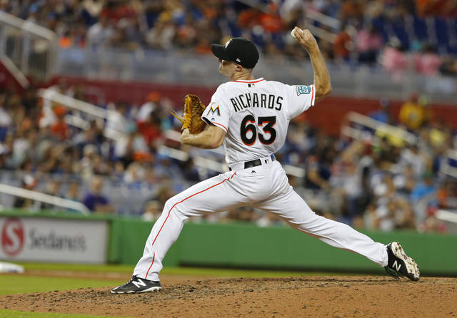 Miami Marlins starting pitcher Trevor Richards throws against the Cincinnati Reds in the sixth inning of a baseball game in Miami, Sunday, Sept. 23, 2018. (AP Photo/Joe Skipper)